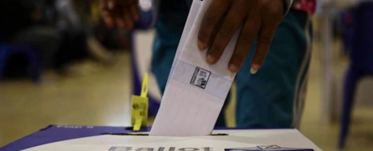 A voter casts his ballot paper. Picture: Cindy Archillies/EWN