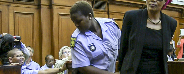 FILE: Convicted murderer Thandi Maqubela is handcuffed after sentencing in the High Court before she is led to the holding cells. Picture: Thomas Holder/EWN