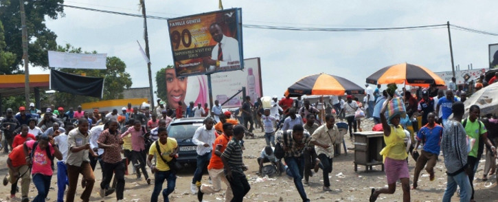 FILE: Protesters run after Democratic Republic of Congo's soldiers opened fire to disperse a crowd of demonstrators on 20 January 2015 in Kinshasa. Picture: AFP.