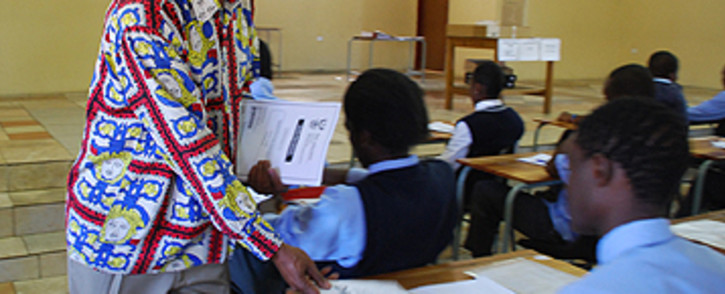 FILE: A teacher hands out matric exam question papers at Moletsane High School in Soweto. Image: Taurai Maduna/Eyewitness News