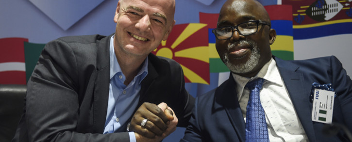 President of Fifa Gianni Infantino (L) shakes hands with President of Nigeria Football Federation Amaju Pinnick during a press conference at the end of the Fifa executive football summit in Lagos, on 20 February 2018. Picture: AFP.