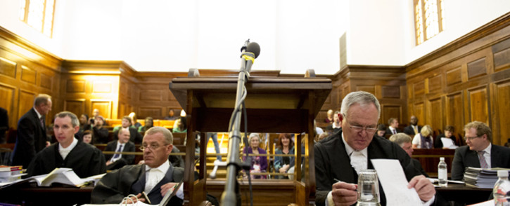 State prosecutor Gerrie Nel and defence lawyer Barry Roux in the Supreme Court of Appeal on 3 November 2015 as the state appeals the culpable homicide conviction of Oscar Pistorius. Picture: Pool