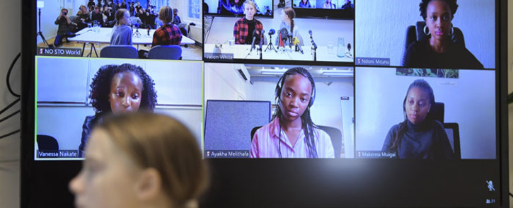 Swedish climate activist Greta Thunberg (foreground) gives a press conference during a meeting with climate activists and experts from Africa on 31 January 2020 in Stockholm. On the screen in background can be seen African participants of the video conference Makenna Muigai (top, R, Fridays For Future, Kenya), climate scientist Ndoni Mcunu (bottom, L) at the Global Change Institute at Witwaterstand University, Vanessa Nakate (bottom, C, Fridays For Future, Uganda) and Ayakha Melithafa (bottom, R, Fridays For Future, South Africa). Picture: AFP