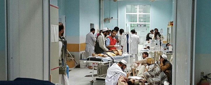 In this undated photograph released by Medecins Sans Frontieres (MSF) on 3 October, 2015, Afghan MSF medical personnel treat civilians injured following an offensive against Taliban militants by Afghan and coalition forces at the MSF hospital in Kunduz. Picture: AFP.