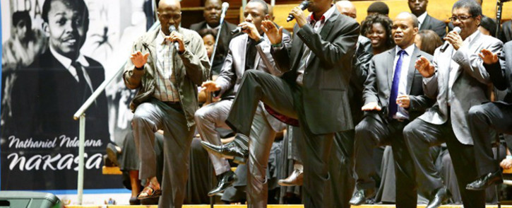 Grammy Award winners Ladysmith Black Mambazo perform a song dedicated to the late anti-apartheid activist and former Drum Magazine journalist Nathaniel Nat Nakasa during Nakasas reburial service at the Durban City hall on 13 September, 2014 in Durban, South Africa. Picture: AFP.