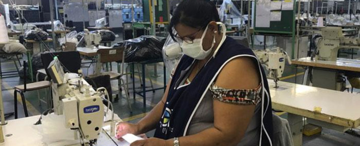 A textile worker at Trade Call Investments Apparel in Epping produces personal protection equipment as she does her bit to help curb the spread of COVID-19. Picture: Jarita Kassen/EWN