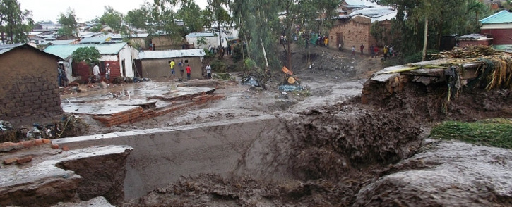 A general view of water flooding the streets of a township is seen on 12 January, 2015 on the outskirts of Malawian capitol, Blantyre. Picture: AFP