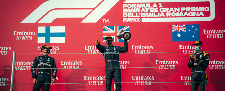 Mercedes driver Lewis Hamilton celebrates his victory in the Emilia Romagna Grand Prix on 1 November 2020. Teammate Valtteri Bottas (left) was second and Renault's Daniel Ricciardo was third. Picture: @MercedesAMGF1/Twitter