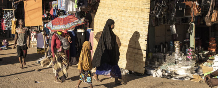 FILE: A woman walks through the central market in Pemba on 25 May 2021. Pemba, the capital of Cabo Delgado, has taken in tens of thousands of people fleeing from violence wreaked by Islamist insurgents across the northern province of Mozambique for over three years. Picture: JOHN WESSELS/AFP