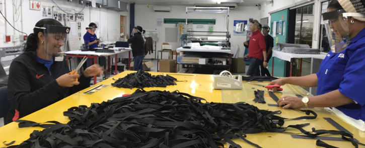 Creative Graphics International in Ottery, Cape Town, has reopened its doors during the 21-day lockdown and is now making personal protective equipment for medical personnel and the general public. Picture: Kevin Brandt/EWN.