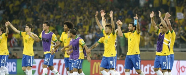 The Brazilian soccer team celebrates after win at Confederations Cup seni-final, 27 June 2013. Picture: AFP.