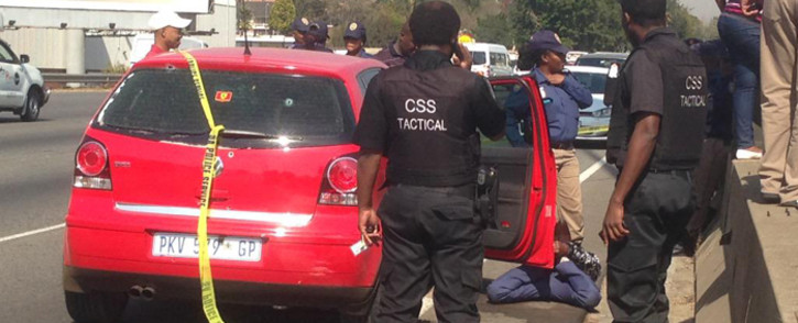 Gauteng police arrested one suspect during a shootout after a car chase on the M1 north on 20 May 2015. Picture: Govan Whittles/EWN.