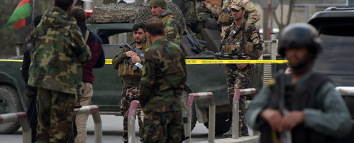 Afghan security personnel gather near the site of an explosion in Kabul on 8 March, 2017. An explosion and gunfire rattled Kabul's diplomatic district, as insurgents attacked Afghanistan's largest military hospital, officials said. Picture: AFP.