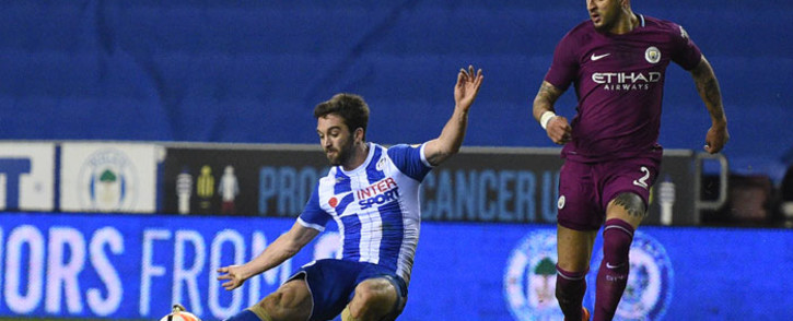 Wigan's Will Grigg scores against Manchester City in their fifth round FA Cup match at the DW Stadium on 19 February 2018. Picture: AFP