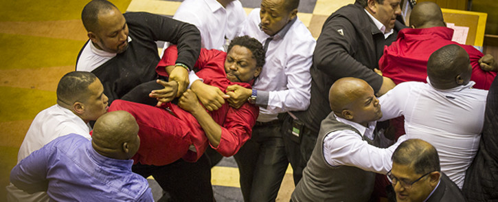 EFF MP Mbuyiseni Ndlozi is forcefully removed from the National Assembly along with other party members on 17 May 2016. Picture: Aletta Harrison/EWN.