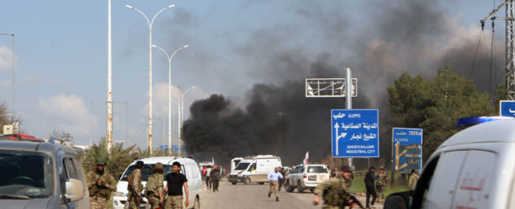 FILE: Smoke billows following a suicide car bombing in Rashidin, west of Aleppo, that targeted buses carrying Syrians evacuated from two besieged government-held towns. Picture: AFP.