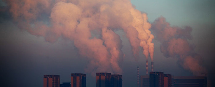 FILE: This picture shows a thermal power plant discharging heavy smog into the air in Changchun, northeast China's Jilin province. Picture: AFP