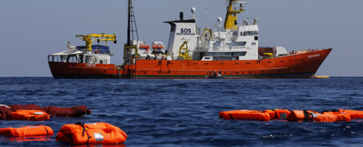FILE: A picture taken on 23 June 2018 shows the 'Aquarius' rescue vessel, chartered by French NGO SOS-Mediterranee and Doctors Without Borders (MSF), during a rescue drill at open sea between Lampedusa and Tunisia. Picture: AFP