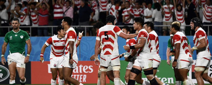 Japan's wing Kenki Fukuoka (C, hidden) celebrates with teammates after scoring a try during the Japan 2019 Rugby World Cup Pool A match between Japan and Ireland at the Shizuoka Stadium Ecopa in Shizuoka on 28 September 2019. Picture: AFP
