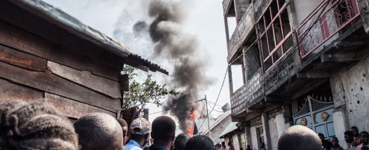 Residents react after a small aircraft carrying around 15 passengers crashed in a densely populated area in Goma on the East of the Democratic Republic of Congo on 24 November 2019. Picture: AFP