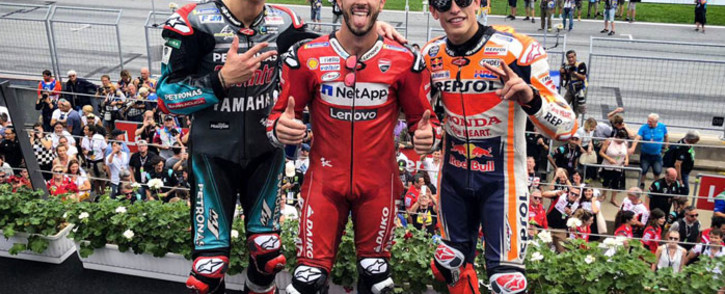 Yamaha's Fabio Quartararo (left), Ducati's Andrea Dovizioso (centre) and Honda's Marc Marquez (right) on the podium after the Austrian round of MotoGP racing on 11 August 2019. Picture: @MotoGP/Twitter