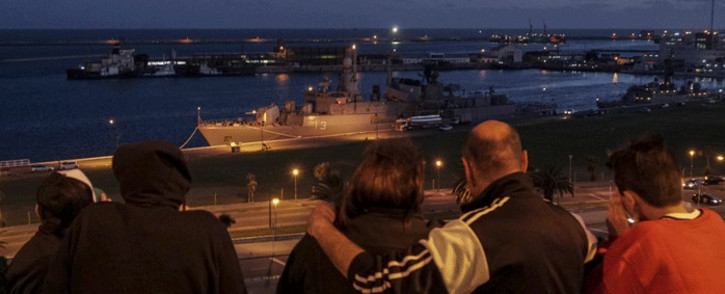 A family looks at Argentine Navy destroyer 'ARA Sarandi' docked at Argentina's Navy base in Mar del Plata, on the Atlantic coast south of Buenos Aires on November 20, 2017 during a search for an Argentine submarine. Picture: AFP.