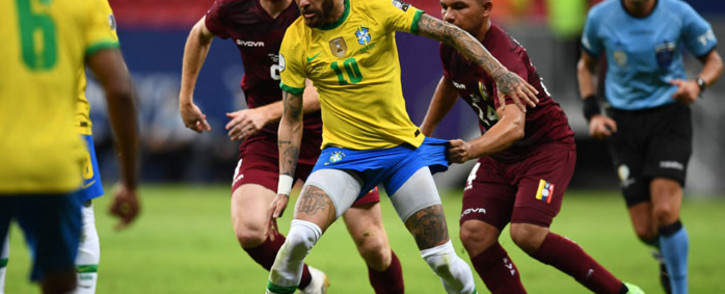 Brazil's Neymar (centre) holds off two Venezuelan players during their Copa America match on 13 June 2021. Picture: @CopaAmerica/Twitter