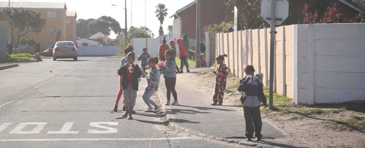 FILE: Children play in the street outside Zeekoevlei primary school in Lotus River Cape Town. EWN looks at how NGO Hope House is making a difference in drug-ridden communities. Picture: Bertram Malgas/EWN