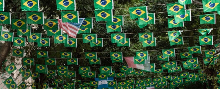 The US investment bank predicts the World Cup host will win the title for a record sixth time. Picture: AFP.