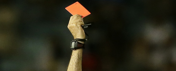 A referee issuing a red card. Picture: EPA.