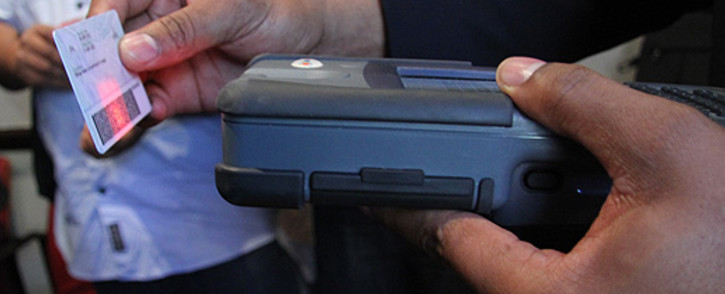 FILE: Department of Home Affairs official scanning the new Smart ID card. Picture: EWN