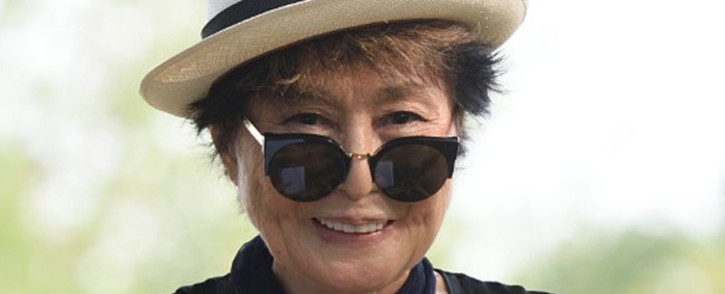 FILE: Yoko Ono smiles during a dedication ceremony for a giant tapestry, from Amnesty International, in honor of John Lennon on Ellis Island 29 July 2015 in New York. Picture: AFP