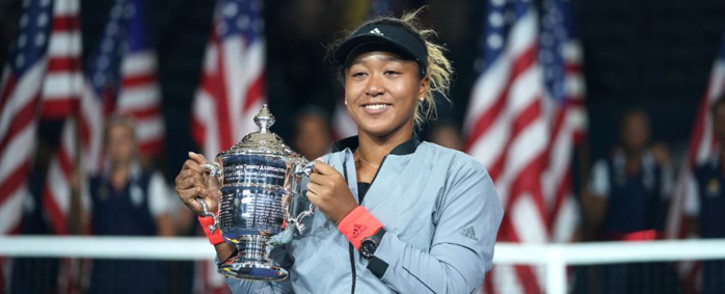 Naomi Osaka holding her trophy after winning the women's singles finals tennis match at the 2018 US Open. Picture: @usopen/Twitter.