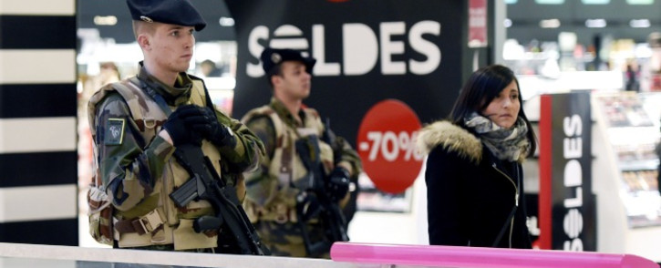 French soldiers patrol in a shopping center in Lyon on 16 January, 2015 , after France announced an unprecedented deployment of thousands of troops. Picture: AFP.
