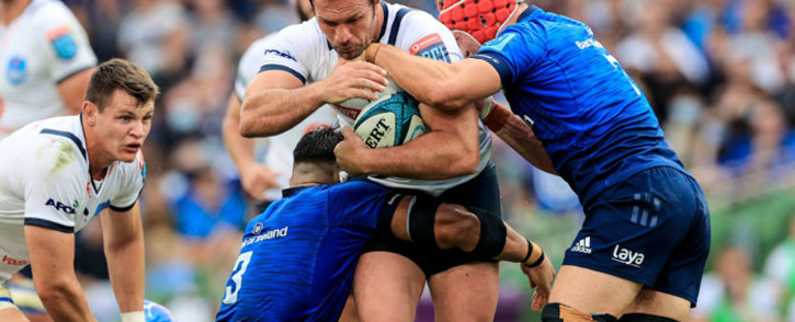 The Bulls' Bismarck du Plessis is tackled by Leinster players in their United Rugby Championship match on 25 September 2021. Picture: @BlueBullsRugby/Twitter