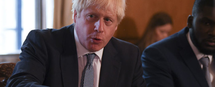 FILE: Britain's Prime Minister Boris Johnson (L) speaks flanked by Youth Justice Board Adviser Roy Sefa-Attakora (R) during a roundtable on the criminal justice system at 10 Downing Street in London on 12 August 2019. Picture: AFP
