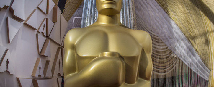 FILE: An Oscars statue is displayed on the red carpet area on the eve of the 92nd Oscars ceremony at the Dolby Theatre in Hollywood, California, on 8 February 2020. Picture: AFP.