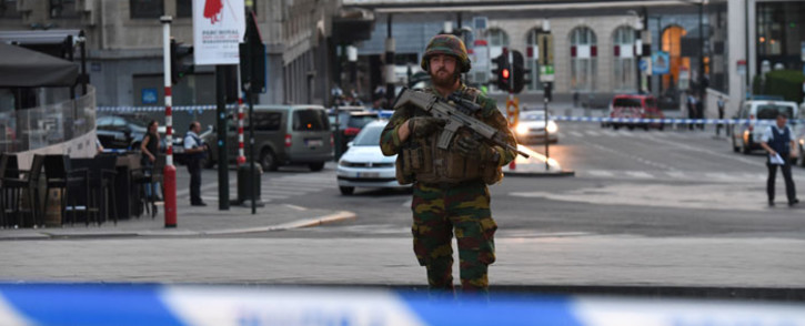 A soldier stands alert in a cordoned off area outside Gare Central in Brussels on June 20, 2017, after an explosion in the Belgian capital. Picture: AFP