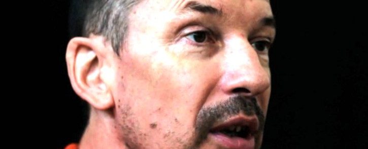 An image grab taken from a video released by the Islamic State organisation through Al-Furqan Media via YouTube on 18 September 2014, allegedly shows British freelance photojournalist, John Cantlie, at an undisclosed location in which he says he is being held captive. Picture: AFP.