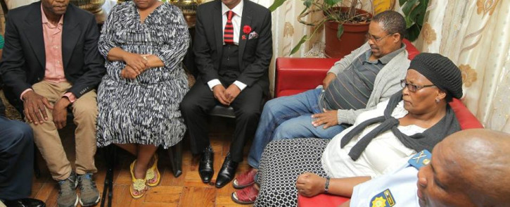 Deputy Police Minister Bongani Mkongi with the family of Unathi Sabsana who was shot dead, allegedly by her partner in New Crossroads. Picture: facebook.com