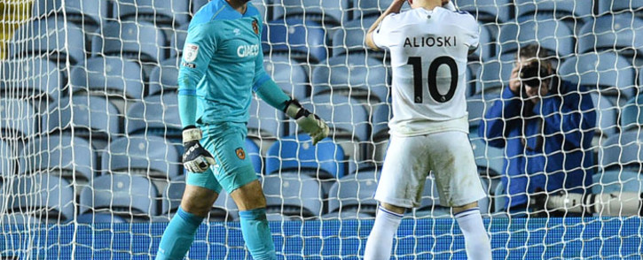 Leeds United midfielder Ezgjan Alioski reacts after hitting the post and failing to score in the penalty shootout during the English League Cup second round football match between Leeds United and Hull City at Elland Road in Leeds, northern England on 16 September 2020. Hull won 9-8 after a penalty shootout. Picture: AFP