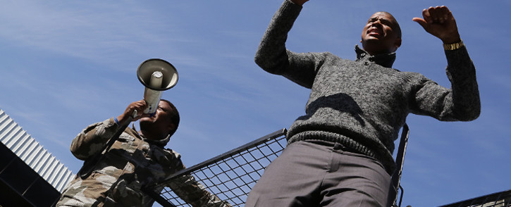 FILE: Andile Lili and Loyiso Nkohla, the men behind Cape Town's 'toilet wars', address their supporters outside the Bellville Magistrates Court on Tuesday 12 August 2014. Picture: Thomas Holder/EWN