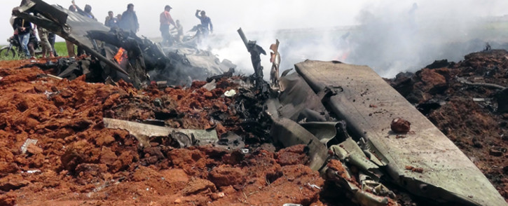 A general view shows the wreckage of a government warplane after Al-Nusra front (Al-Qaeda's Syria affiliate) repotedly shot it down over the northern Syrian town of Al-Eis on April 5, 2016 and captured one crew member alive, a rebel source and the Syrian Observatory for Human Rights said. The monitoring group said Al-Nusra downed the plane, which it said was likely being flown by a Syrian air force pilot. Picture: AFP.