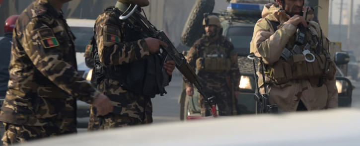 FILE: Afghan security personnel block a road near the site of a bomb blast in Kabul. Picture: AFP
