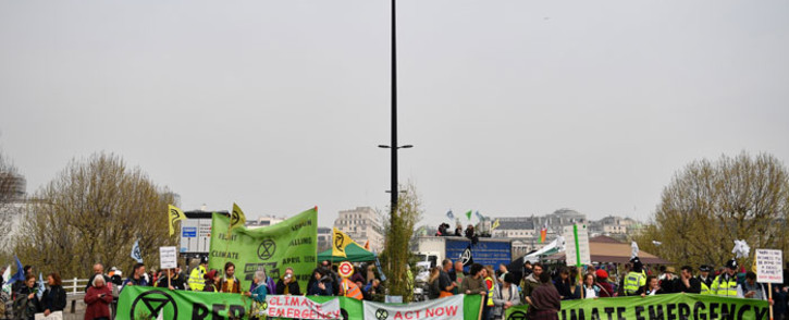 Activists hold banners and wave flags as they continue to block on Waterloo Bridge on the second day of an environmental protest by the Extinction Rebellion group, in London on 16 April 2019. Picture: AFP