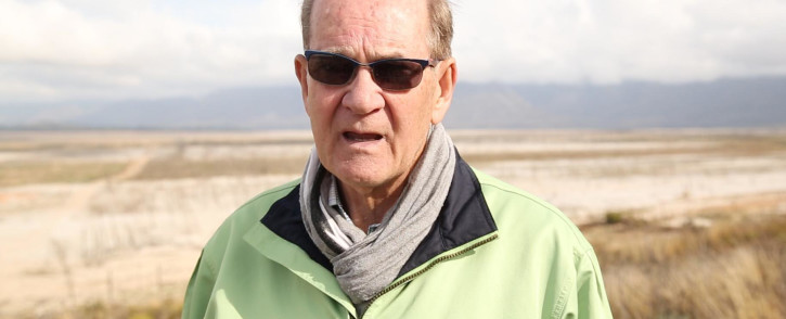A shallow stream of water runs through the Theewaterskloof Dam, as dam levels stand at 14%.  The Deputy Director General of Water and Sanitation Trevor Balzer, is discussing solutions to get more water from the dam and into the city.  Picture: Bertram Malgas