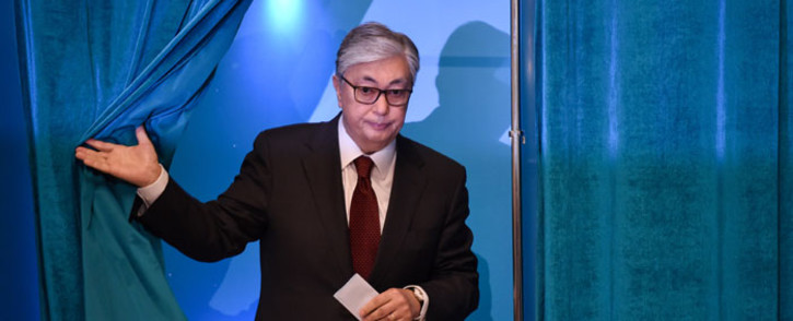 Kazakh President and presidential candidate Kassym-Jomart Tokayev walks out of a voting booth at a polling station during Kazakhstan's presidential elections in Nur-Sultan on 9 June 2019.  Picture: AFP