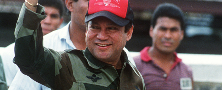 This file photo taken on October 04, 1989 shows former Panamanian strongman General Manuel Noriega waving as he leaves his headquarters in Panama City following a failed coup against him. Picture: AFP