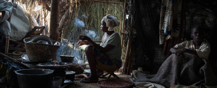 A displaced Christian woman cooks dinner at the largest displacement site located outside the French military base in Bambari, Central African Republic. Picture: EPA/Tanya Bindra.