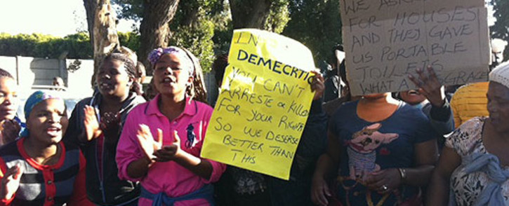 Residents protest outside the Bellville Magistrates Court for basic sanitation on 8 July 2013. Picture: Lauren Isaacs/EWN